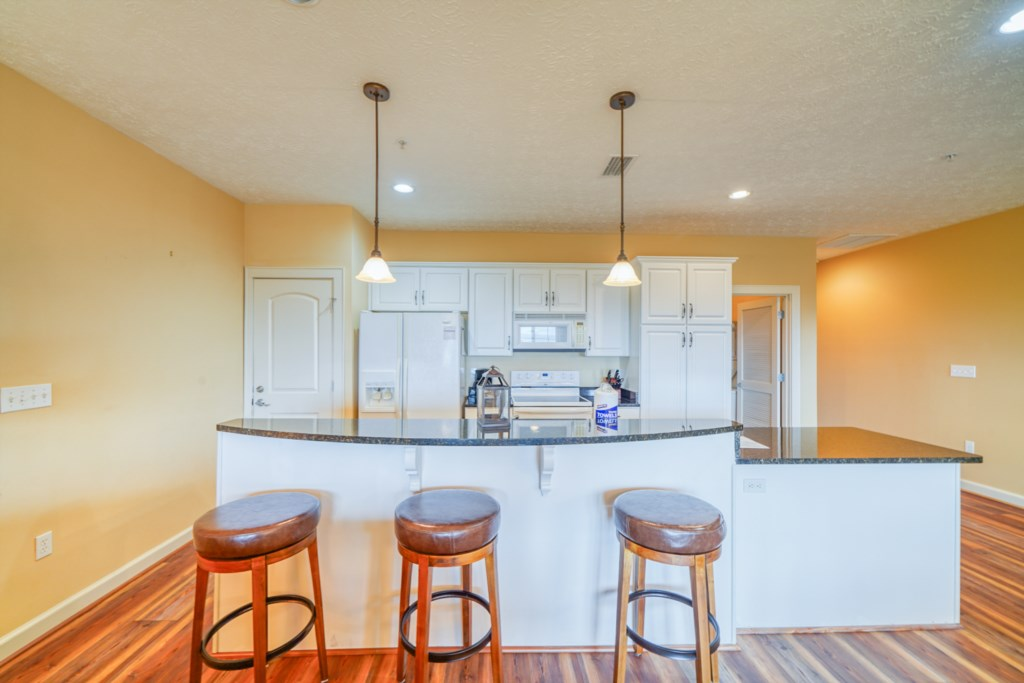 Ample seating between the kitchen bar and dining room table