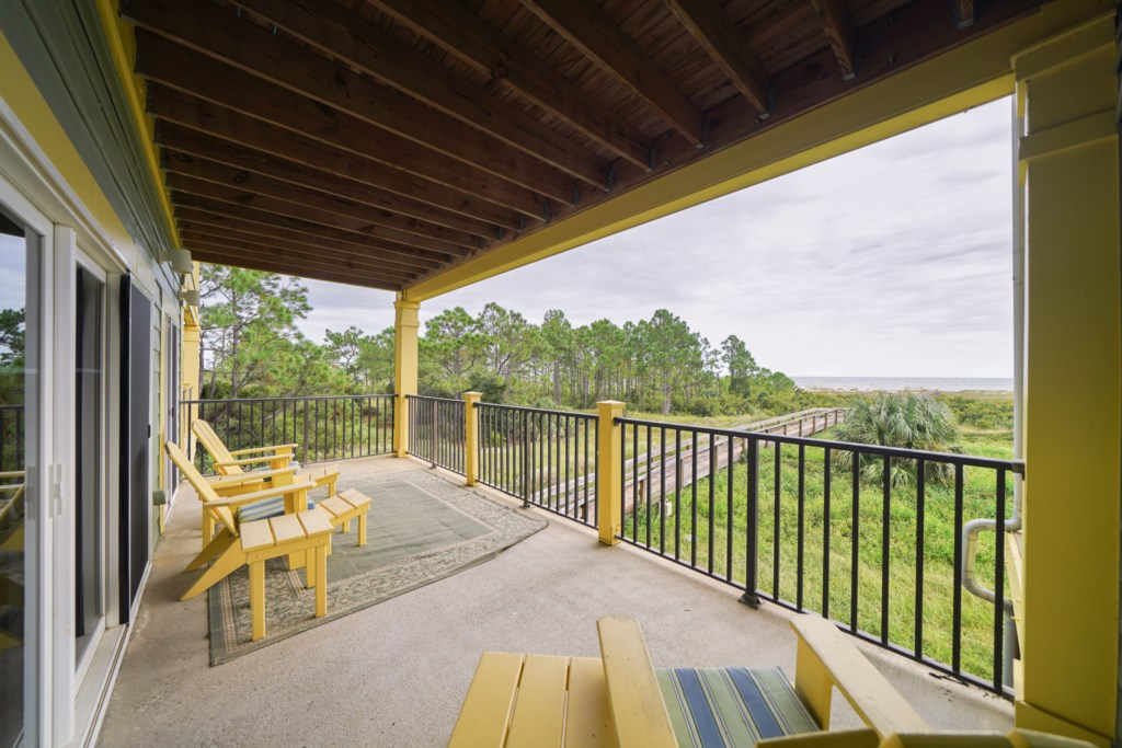 Beat the sun on the covered balcony and enjoy unobstructed views