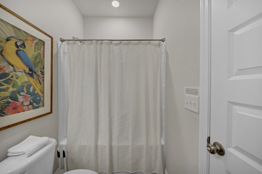 The guest bath features a shower/tub combination