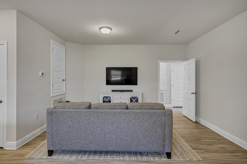 Additional living rom with sectional and flat, SMART, television