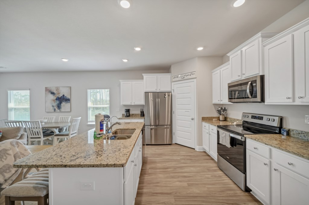 Beautiful kitchen with stainless appliances and stone countertops