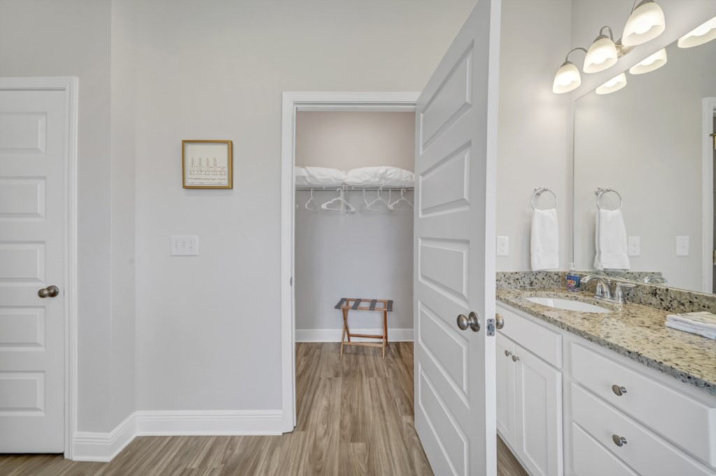 Walk-in closet with plenty of space for those pesky suitcases