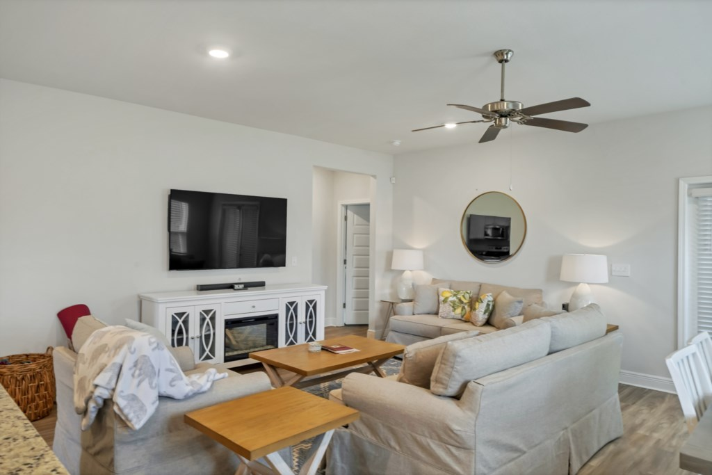 The first living room offers a large, SMART, flat screen television and plush, comfortable seating