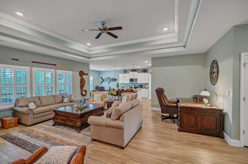 Decorative tray ceilings with plantation shutters elevate the interior décor