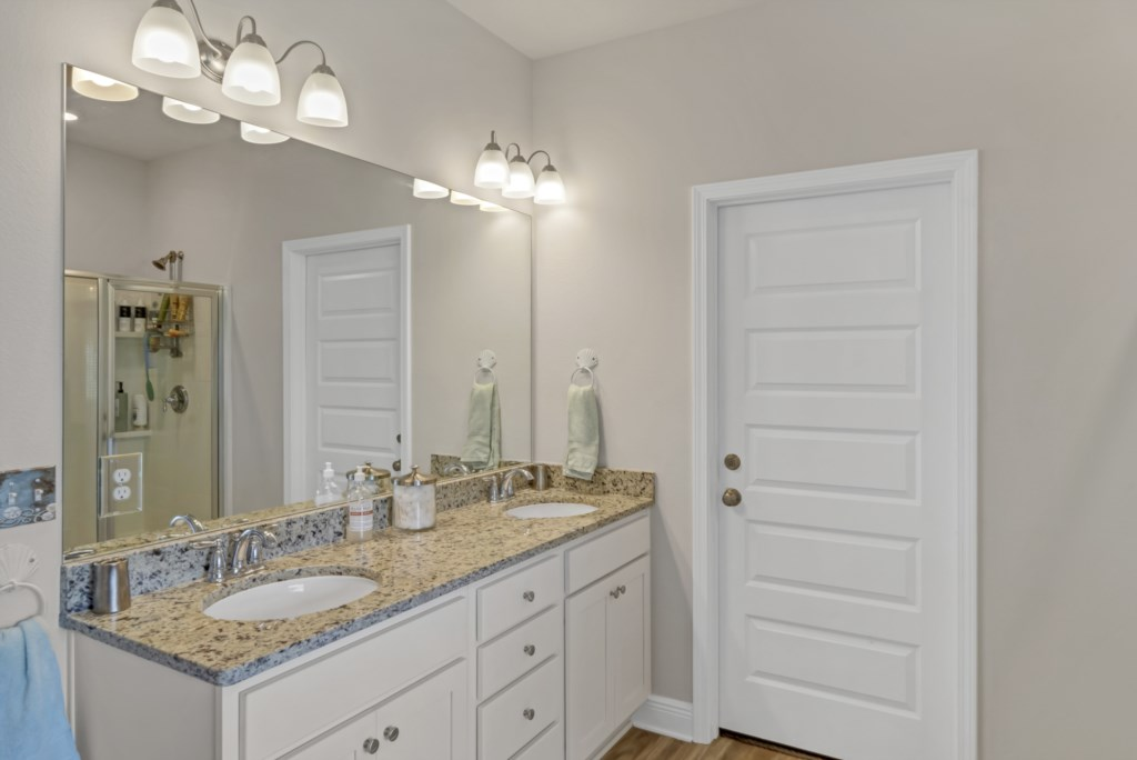 Double vanities, large walk-in closet, and private water closet compose the primary bath